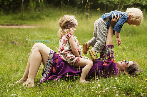 Mother and Children Playing in Field